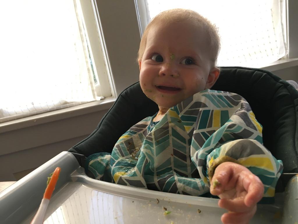 child eating avocado