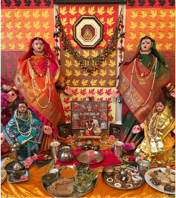 Goddess Gauri dolls and the food offerings